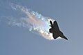 A U.S. Air Force F-22 Raptor banks left causing vapor contrails (32517126414).jpg