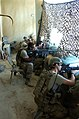 A U.S. Airman and Soldiers with Delta Company, 1st Battalion, 503rd Infantry Regiment, 173rd Airborne Brigade Combat Team watch a village after taking small-arms fire at Combat Outpost Kherwar, Afghanistan 120805-A-ZZ999-056.jpg