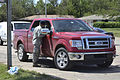A U.S. Airman with the Oklahoma Air National Guard speaks with the driver of a pickup truck in Moore, Okla., May 28, 2013 130528-Z-TK779-010.jpg