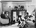 A family relaxes at home in Taunton, Somerset, on a Sunday afternoon during 1942. D12274.jpg