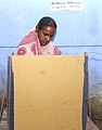 A female voter casting her vote at a polling station, in Abadanga, Birbhum district, during the Assembly Election in West Bengal on April 23, 2011.jpg
