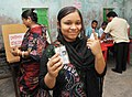 A first time voter showing mark of indelible ink after casting her vote, at a polling booth, during the 7th Phase of General Elections-2014, in Baruipara (Hooghly), West Bengal on April 30, 2014.jpg