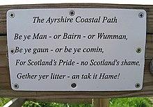 "Sign reading ""The Ayrshire Coastal Path/Be ye man or Bairn or Wumman,/Be ye gaun or be ye comin,/For Scotland's Pride - no Scotland's shame,/Gather yer litter - an tak it Hame!"""