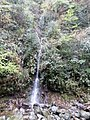 A waterfall cascades down the cliff of Mount Fanjing.jpg