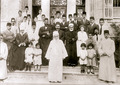 Abdul Baha with grandsons and other Baha'is.png