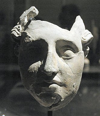 Ai-Khanoum - Stucco face found in the administrative palace. Ai-Khanoum, 2nd century BC