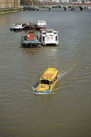 Amphibious vehicle - Amphibious tour bus -  a converted DUKW - on Thames river in London near Lambeth Bridge.