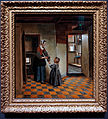 Amsterdam - Rijksmuseum 1885 - The Gallery of Honour (1st Floor) - Woman with a Child in a Pantry c.1656-60 by Pieter de Hooch.jpg