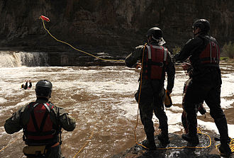 Swift water rescue - Usage of a throw bag in a swift water rescue exercise