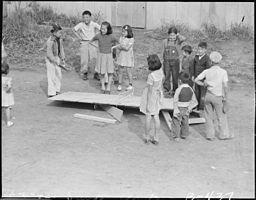 Arcadia, California. An impoverished ping pong table collapses in the midst of a game among youngst . . . - NARA - 537052