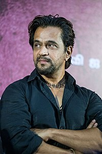 Arjun at the 'Kolaigaran' Press Meet.jpg