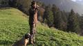 Austrian hunter blowing horn.png