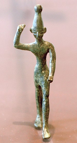 Baal, right arm raised. Bronze figurine, 14th-...