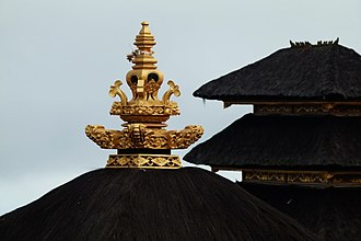 Finial - a Balinese kemuncak on top of a thatched roof of a Balinese temple pavilion.