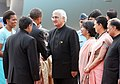 Barack Obama and the First Lady Mrs. Michelle Obama being welcomed by the Minister of State (Independent Charge) for Corporate Affairs and Minority Affairs, Shri Salman Khurshid, on their arrival, at Palam Air Force Station.jpg