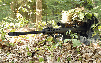 Anti-materiel rifle - A sniper using a Barrett M82 anti-material rifle.