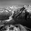 Barrier Glacier, terminus of piedmont glacier, icefall on the upper sections of the glacier and hanging glaciers and mountain (GLACIERS 6509).jpg