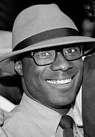 A black and white photograph of Barry Jenkins attending his 30th birthday party