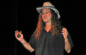 Ben Goertzel giving a talk at the Singularity ...
