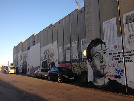 Graffiti depicting Zuckerberg on the Israeli West Bank barrier in Bethlehem, July 2018 Bethlehem wall graffiti Mandela, Sanders, Trump, Zuckerberg.jpeg