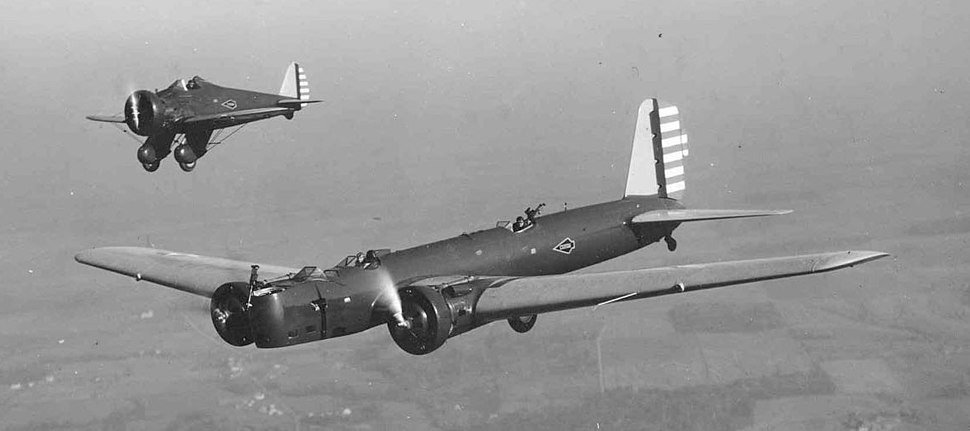 Boeing Y1B-9A and P-26 in flight (060421-F-1234P-043) (tight crop, contrast stretch)