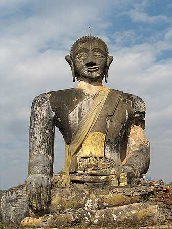 A bombed Buddha statue in Laos. U.S. bombing campaigns made the country the single most bombed country in history. Bombed Buddha - panoramio.jpg