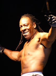 Booker T posing in a wrestling ring