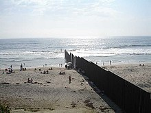 A Border Wall On A Beach Separating United States   Mexico