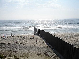 Playas de Tijuana - View of the U.S.-Mexico border fence from Playas de Tijuana, at the left. Before fortification