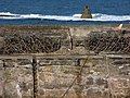 Breakwater, Craster with navigational aid on Little Carr behind - geograph.org.uk - 934520.jpg