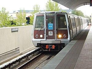 A train headed by a Breda 3000-series set arri...