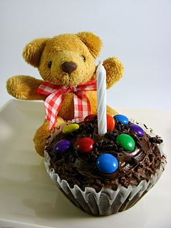 Brownie cupcake with teddy bear and candle