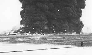 Bien Hoa Air Base - Burning Aircraft on ramp at Bien Hoa AB after explosion