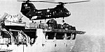 CH-46D Sea Knight of HC-6 hover over USS Concord (AFS-5) in July 1977.jpg