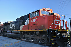 Canadian National 8800, an EMD SD70M-2 diesel-electric locomotive, photographed from the front-right and up close as it moves slowly through Harvey, Illinois.