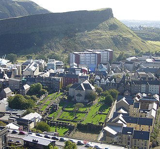 Canongate Kirkyard - Canongate Kirk, seen from Calton Hill, with the churchyard in the foreground, and Salisbury Crags behind