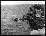 Capsized skiff dragged to shore at Clark Island, Sydney (7653397708).jpg