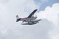 Cessna A185F N363JV Overhead 07 SNFSI FOF 15April2010 (14650276063).jpg