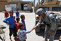 Charlotte Resident Serving in Afghanistan Extends a Hand to Afghan Boy DVIDS300286.jpg