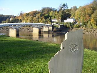 "Wales Coast Path - The stone at Chepstow marking the southern end of the Wales Coast Path, with the path's ""dragon shell"" logo"