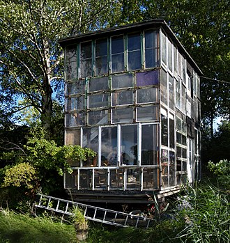 "Freetown Christiania - Glass house in Freetown Christiania, one of the many idiosyncratic constructions exemplifying modern ""architecture without architects""."