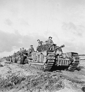 History of the Scots Guards (1914–1945) - Churchill tanks of the 3rd Battalion, Scots Guards, 6th Guards Tank Brigade, with infantrymen of the 2nd Battalion, Argyll and Sutherland Highlanders, advance near Beringe in Holland, 22 November 1944.