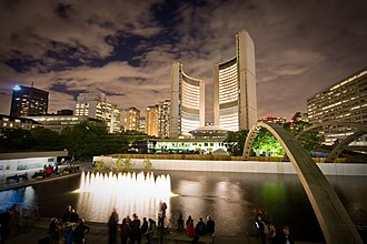 Toronto City Hall - The design of City Hall features two curved towers that rise from differing heights, and a public square featuring a reflecting pool.