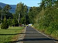 Closer toward center of town the trail is paved. (27473876355).jpg