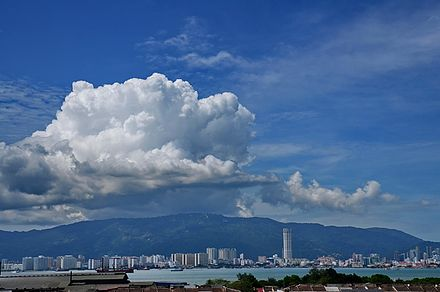 View of George Town as seen from Seberang Perai, with Penang Hill in the background Clouds above Penang.jpg