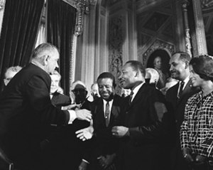 Clarence Mitchell Jr. - President Lyndon Johnson with Mitchell, Martin Luther King, Jr. (in center of group), and other civil rights leaders at the signing of the landmark Voting Rights Act in 1965.