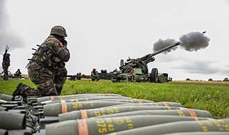 3rd Marine Artillery Regiment - French soldiers of 3rd Marine Artillery Regiment fire a French TRF1 155 mm howitzer as part of a live fire exercise during Combined Endeavor at the Joint Multinational Training Command's Grafenwoehr Training Area, Germany, Sept. 17, 2013.
