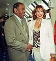 Congressman John Conyers greets Raquel Welch at National press club 2 cropped (48591893876).jpg