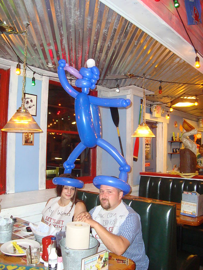 English: 2 person balloon hat paroding the Coo...