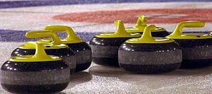 Curling stones yellow.jpg